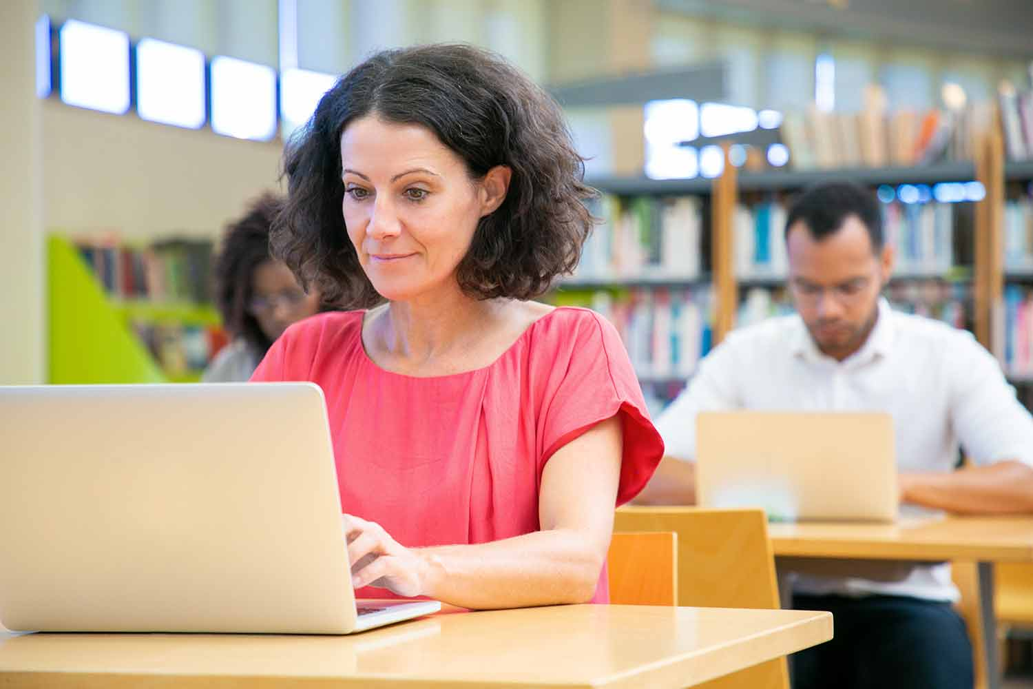 Happy female adult student passing online test